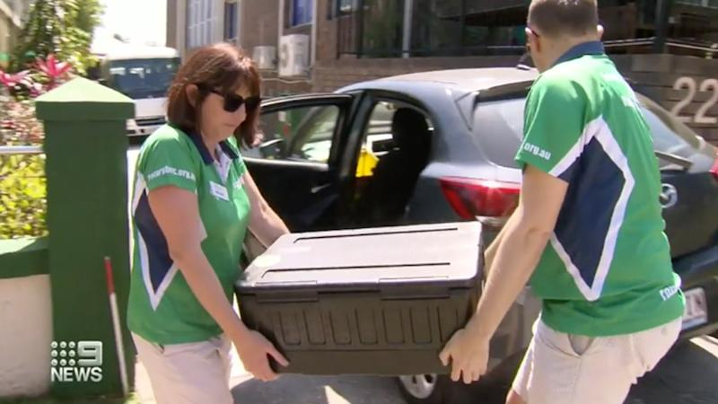 Rotary members Brooke Thomas (left) and Will Bassett (right) delivering meals to the homeless or vulnerable in Brisbane.