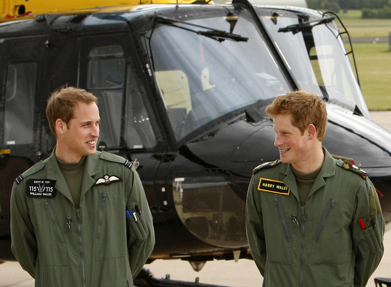 FILE - In this June 18, 2009 file photo, Britain's Prince William, left, and Prince Harry pose during a photocall at the Royal Air Force base at Shawbury, England. Military service is a tradition for the men of Britain's royal family, but combat has been off-limits for the next in line of succession. (AP Photo/Kirsty Wigglesworth, File)