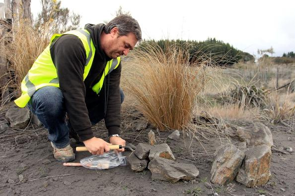 Dr Jon Procter from Massey University collects an ash sample after Mt Tongariro erupted for the first time in over 100 years on August 7, 2012 in Tongariro National Park, New Zealand. Mt Tongariro erupted intermittently from 1855 to 1897. Although not an immediate threat to the community, the latest eruption may be the beginning of weeks, months or even years of volcanic activity. (Photo by Hagen Hopkins/Getty Images)