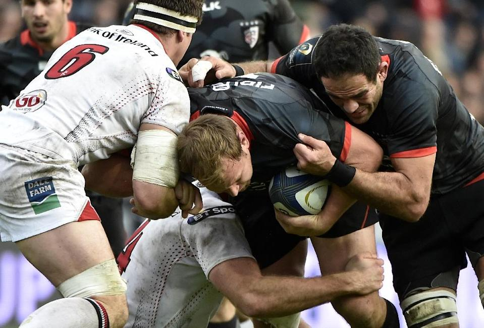 Toulouse flanker Gregory Lamboley (R) and scrum-half Gert Muller (C) drive against Ulster lock Alan O'Connor (hidden) and flanker Robbie Diack during their European Rugby Union Champions Cup match, on December 20, 2015 at the Ernest Wallon Stadium (AFP Photo/Pascal Pavani)