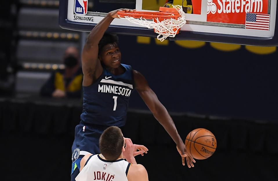 Jan 5, 2021; Denver, Colorado, USA;  Minnesota Timberwolves guard Anthony Edwards (1) dunks over Denver Nuggets center Nikola Jokic (15) in the second quarter at Ball Arena. Mandatory Credit: Ron Chenoy-USA TODAY Sports