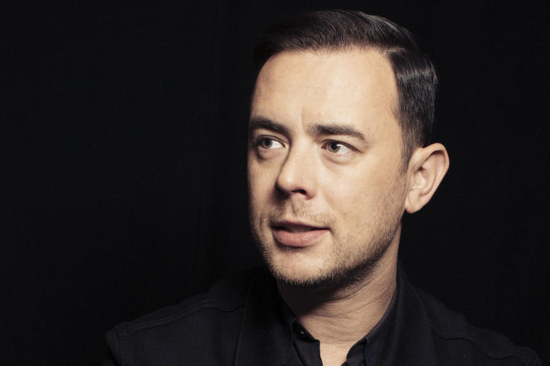"In this Oct. 26, 2016 photo, Colin Hanks poses for a portrait in New York to promote his series, ""Life in Pieces."" Hanks will direct an upcoming documentary on the American band, Eagles of Death Metal, before and after the 2015 Paris terror attack at one of their concerts that killed 89 people. (Photo by Victoria Will]/Invision/AP)"