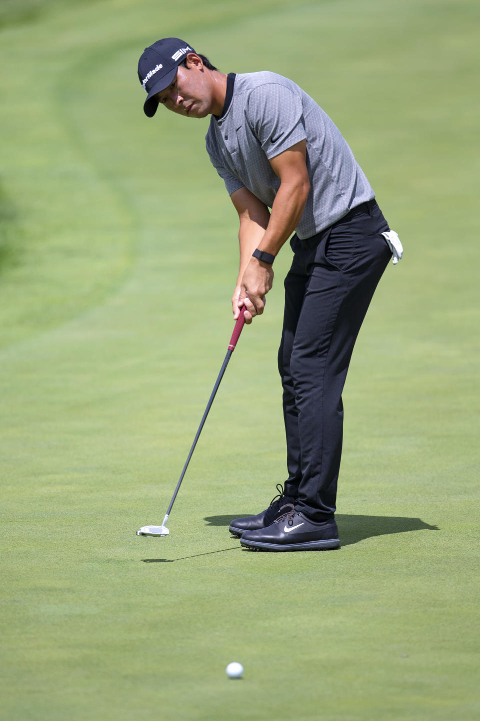 Xinjun Zhang putts on the ninth hole during the first round of the 3M Open golf tournament in Blaine, Minn., Thursday, July 23, 2020. (AP Photo/Andy Clayton- King)