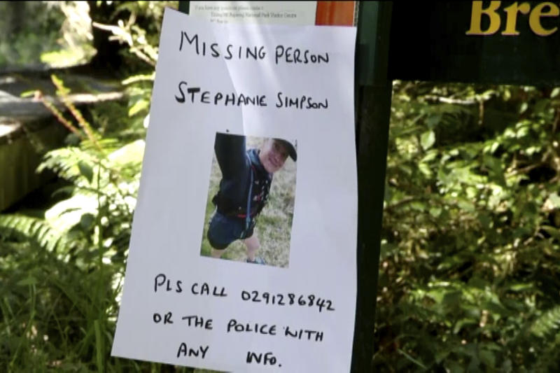 This Tuesday, Feb. 11, 2020, image made from video shows a poster with a photo of British hiker Stephanie Simpson at Mount Aspiring National Park, New Zealand. Searchers found the body of Simpson on Friday, Feb. 14, 2020, almost a week after she went hiking in the national park. (Newshub via AP)