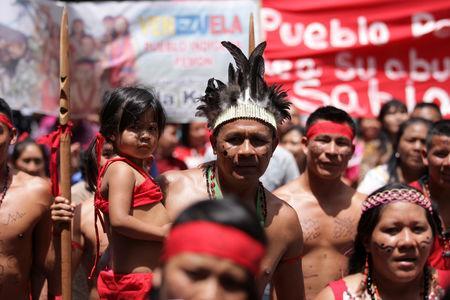 FILE PHOTO: Pemon Indians protest outside the German Embassy demanding the return of the sacred 'Kueka Stone' in Caracas, June 21, 2012. REUTERS/Christian Veron/File Photo