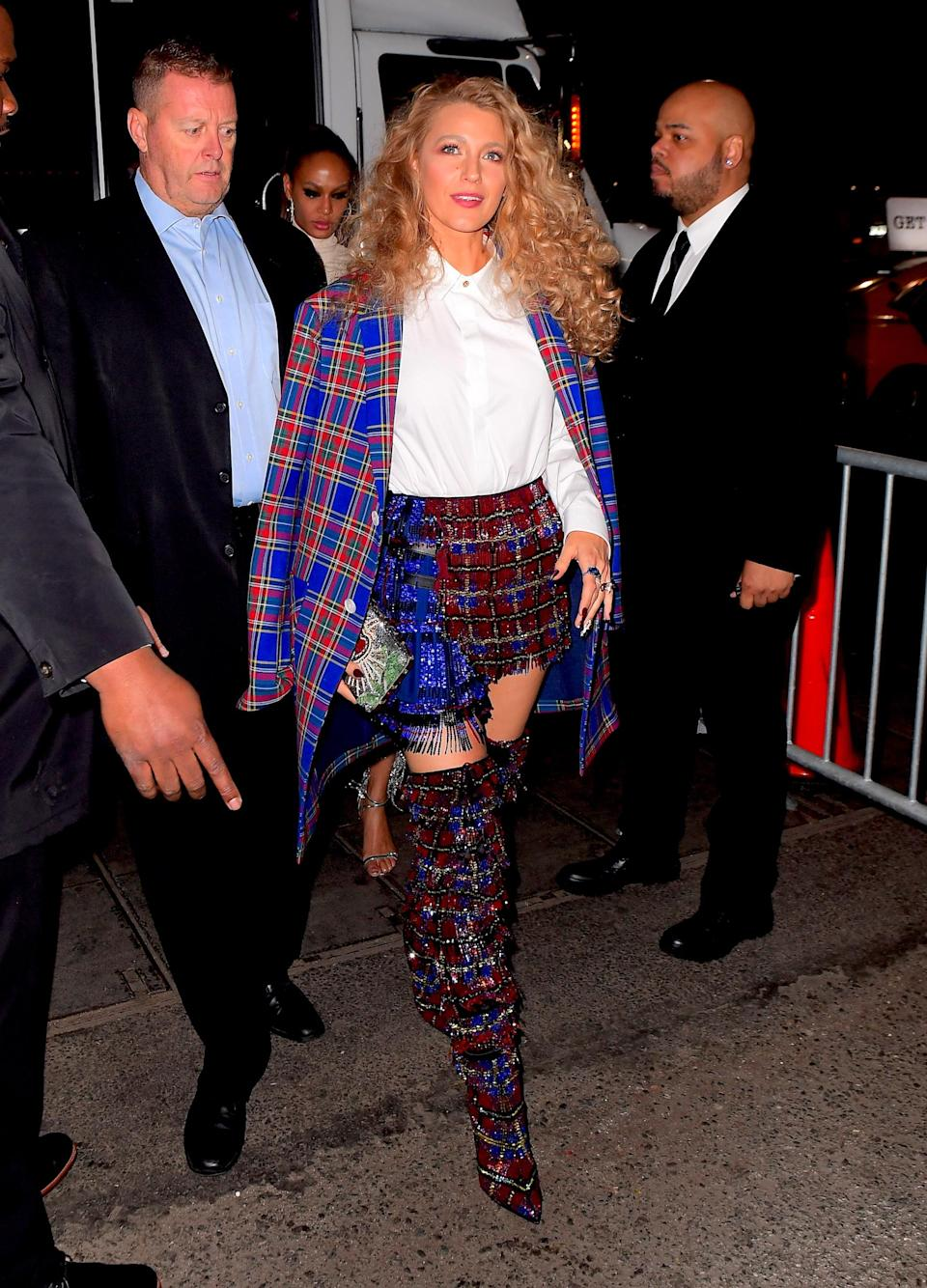 <p>The fashion didn't stop at the Metropolitan Museum for Blake Lively on Monday night. She continued her fashion reign as one of the night's best dressed as she changed out of her stunning Versace gown into a tartan ensemble with a mini skirt, matching knee high boots, and a blue jacket draped over her shoulders. (Photo: Splash News) </p>