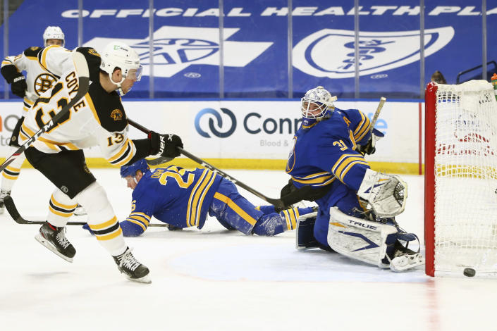 Buffalo Sabres goalie Dustin Tokarski (3) stops Boston Bruins forward Charlie Coyle (13) during the first period of an NHL hockey game, Tuesday, April 20, 2021, in Buffalo, N.Y. (AP Photo/Jeffrey T. Barnes)
