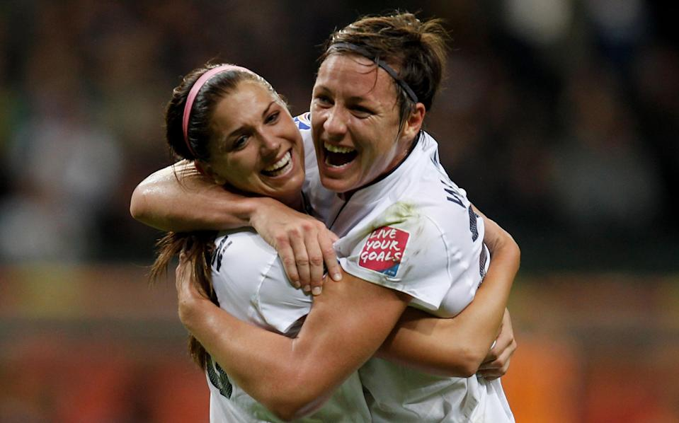 FRANKFURT AM MAIN, GERMANY - JULY 17: Alex Morgan (L) of USA celebrates scoring the first goal with Abby Wambach (R) during the FIFA Women's World Cup Final match between Japan and USA at the FIFA World Cup stadium Frankfurt on July 17, 2011 in Frankfurt am Main, Germany. (Photo by Friedemann Vogel/Getty Images)