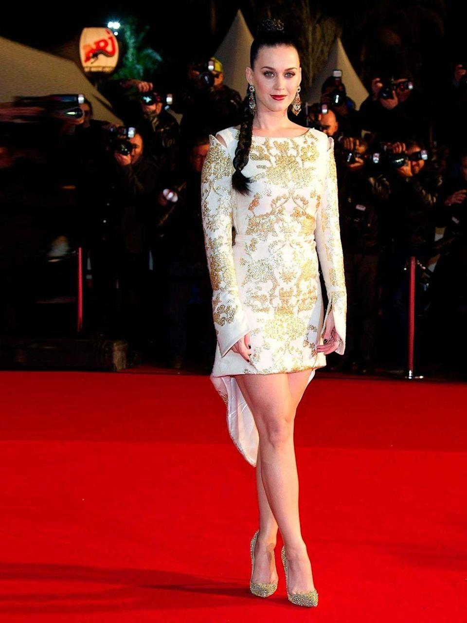 <p>Katy Perry wears an Osman AW13 ivory long-sleeved dress with Christian Louboutin Strass Pigalle pumps.</p>