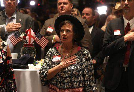 Supporters recite the Pledge of Allegiance at Republican U.S. Senate candidate Roy Moore's election night party in Montgomery, Alabama, U.S. December 12, 2017. REUTERS/Carlo Allegri