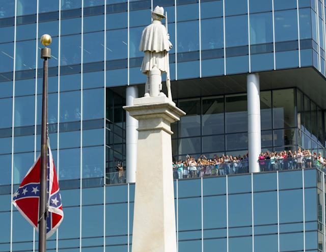 <p>The Confederate battle flag is removed from the pole at the South Carolina statehouse grounds during a ceremony in Columbia, July 10, 2015. South Carolina removed the Confederate battle flag from the state capitol grounds after three weeks of emotional debate over the banner, a symbol of slavery and racism to many, of Southern heritage and pride to others. (Photo: Jason Miczek/Reuters) </p>