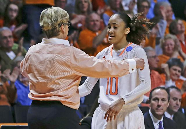 Tennessee head coach Holly Warlick hugs guard Meighan Simmons (10) as Simmons leaves the game late in the second half of an NCAA women's college basketball second-round tournament game against St. John's Monday, March 24, 2014, in Knoxville, Tenn. Simmons scored 17 points as Tennessee won 67-51. (AP Photo/Mark Humphrey)