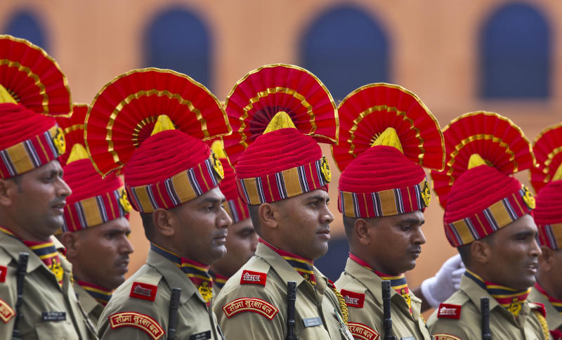 Indian Sashastra Seema Bal personnel take part in the Independence Day celebration parade in Gauhati, India, Thursday, Aug. 15, 2019. Indian Prime Minister Narendra Modi defended his government's controversial measure to strip the disputed Kashmir region of its statehood and special constitutional provisions in an Independence Day speech Thursday, as about 4 million Kashmiris stayed indoors for the 11th day of an unprecedented security lockdown and communications blackout. (AP Photo/Anupam Nath)