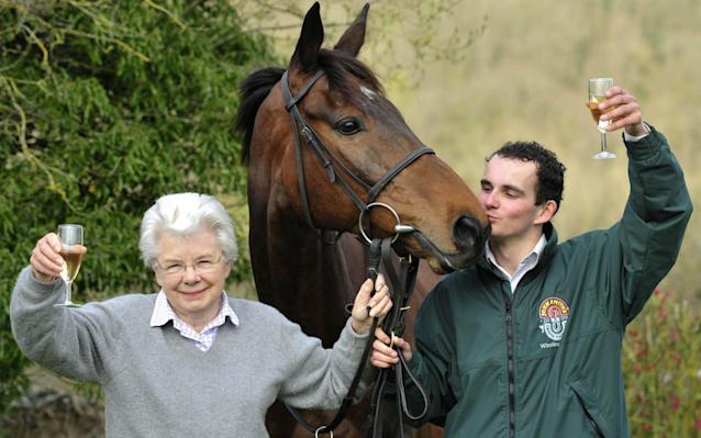 <span>Champers-ing at the bit: Grand National winner Mon Mome with winning jockey Liam Treadwell and owner Vida Bingham</span> <span>Credit: PA </span>
