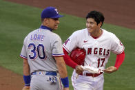 Los Angeles Angels' Shohei Ohtani, right, talks with Texas Rangers first baseman Nate Lowe after being thrown out at first during the first inning of a baseball game Monday, April 19, 2021, in Anaheim, Calif. (AP Photo/Mark J. Terrill)
