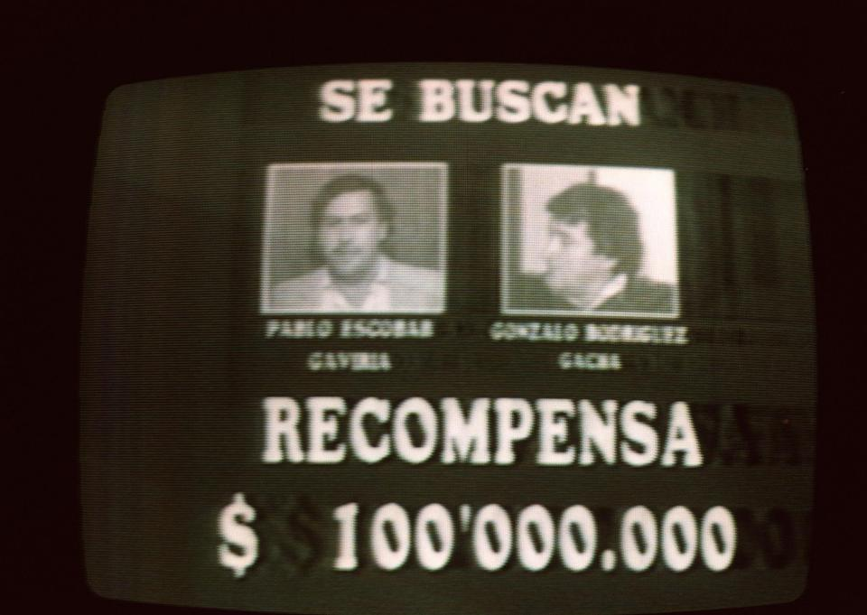 BOGOTA, COLOMBIA - SEPTEMBER 6:  An image taken 06 September 1989 from Colombian television of a wanted advertisement for Medellin drug cartel leaders Pablo Escobar and Gonzalo Rodriguez.  (Photo credit should read CARLOS LEMA/AFP via Getty Images)