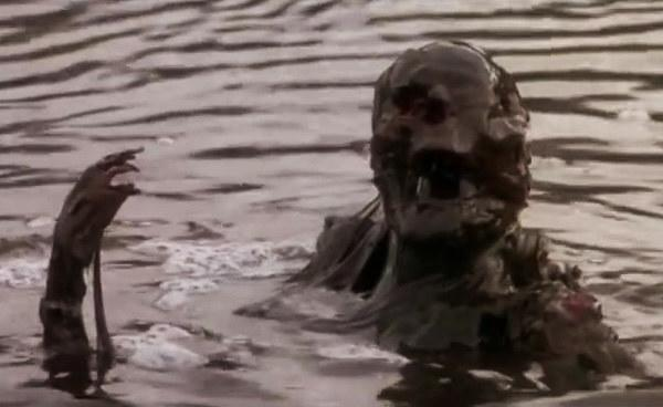 A skeleton covered in muck