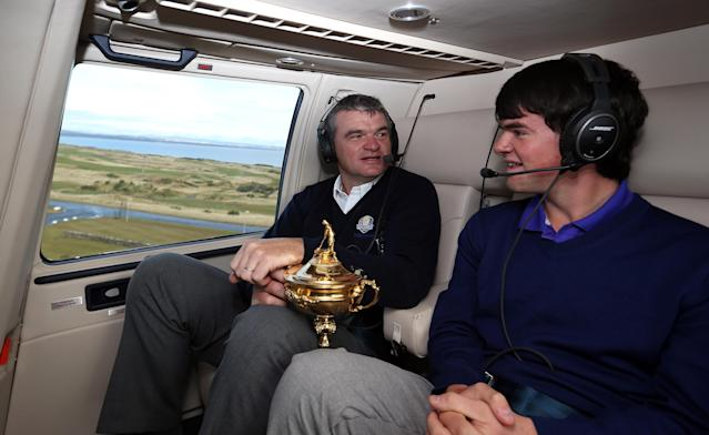 AUCHTERARDER, SCOTLAND - OCTOBER 03: Paul Lawrie of Scotland and his son Craig Lawrie fly in to the grounds of the Gleneagles Hotel during the offical handover of the Ryder Cup to The Gleneagles Hotel, the hosts of the 2014 event, at Gleneagles on October 3, 2012 in Auchterarder, Scotland. (Photo by Ross Kinnaird/Getty Images)