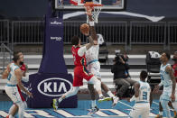 New Orleans Pelicans guard Lonzo Ball (2) tries to shoot over Charlotte Hornets center Bismark Biyombo during the second half of an NBA basketball game Sunday, May 9, 2021, in Charlotte, N.C. (AP Photo/Brian Westerholt)
