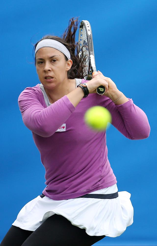 France's Marion Bartoli in action against Flavia Pennetta during the AEGON International at Devonshire Park, Eastbourne.