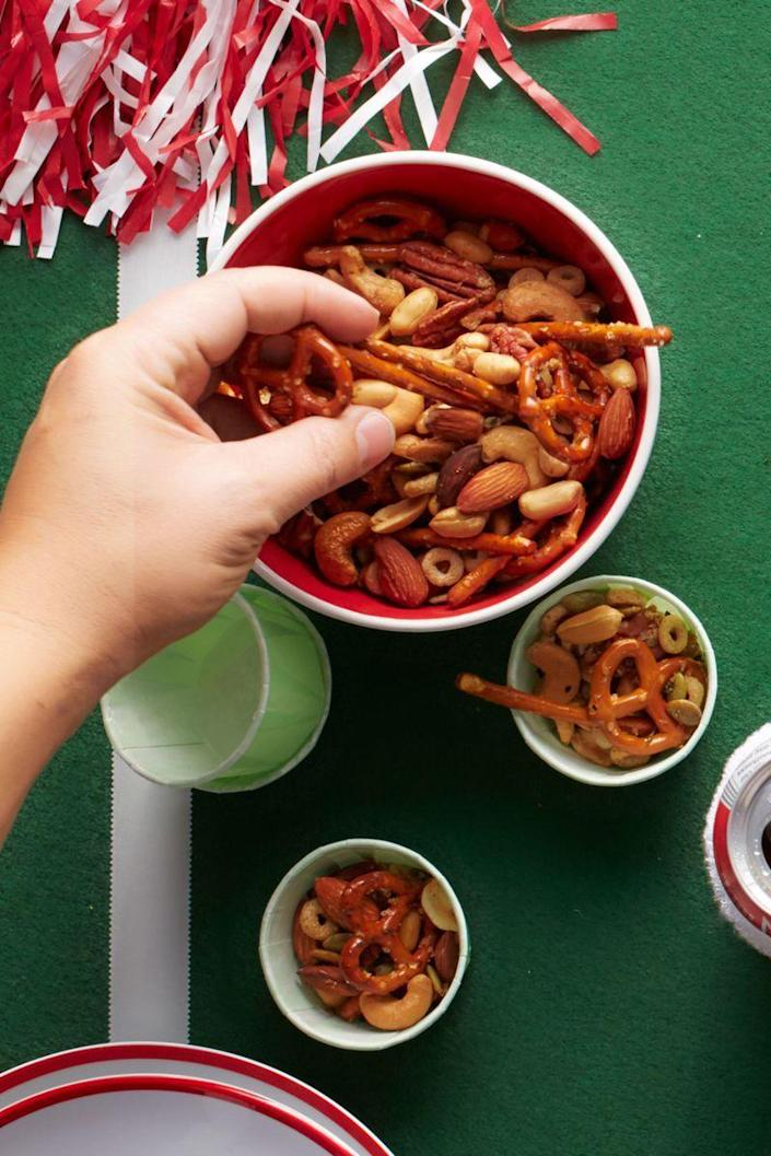 """<p>Don't buy the pre-made stuff — it's easy to make your own snack mix at home, for a lot less.</p><p><a href=""""https://www.womansday.com/food-recipes/food-drinks/recipes/a53329/snack-mix/"""" rel=""""nofollow noopener"""" target=""""_blank"""" data-ylk=""""slk:Get the Snack Mix recipe."""" class=""""link rapid-noclick-resp""""><em>Get the Snack Mix recipe.</em></a> </p>"""