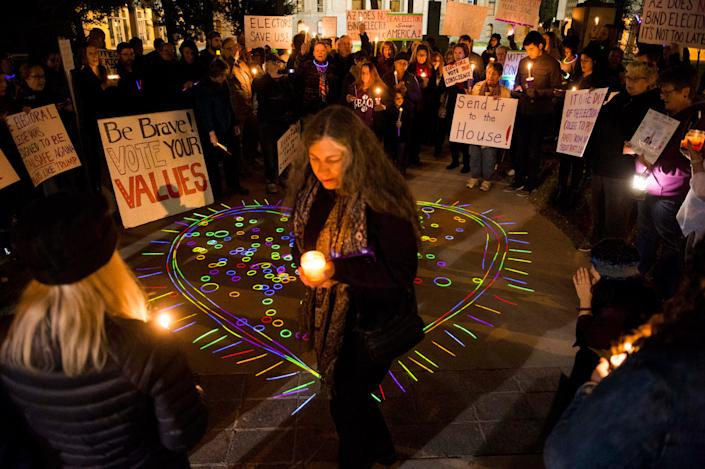 Rena Weiss of Tucson, Arizona, joins a vigil at the Arizona State Capitol in Phoenix to urge members of the Electoral College to cast their votes for anyone other than President-elect Donald Trump in 2016.