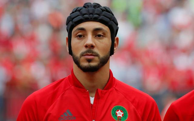 "A concussion row erupted at a second successive World Cup on Wednesday after a player returned to action five days after being in hospital. Morocco made a mockery of Fifa protocol on head injuries by picking Watford winger Nordin Amrabat against Portugal in defiance of guidelines that concussed players should not return for six days. The 31-year-old, taken off in his country's loss to Iran after a 72nd-minute clash of heads with Vahid Amiri on Friday, even began the game in protective headgear which he soon discarded, drawing condemnation from the world players' union, FifPro, and brain-injury experts. The chairman of Fifa's medical committee, Michel D'Hooghe, announced he would seek an explanation from Morocco's team doctor about the decision to allow Amrabat to play. But the controversy also raised serious questions about whether the governing body's protocol – debuting in Russia four years after a string of concussion incidents in Brazil – was fit for purpose and needed to become a rule with concrete sanctions. Amrabat, who spent one night in hospital after Friday's game, revealed he had defied doctor's orders by playing yesterday. ""I am my own doctor,"" he declared before admitting he hoped he had not done himself any ""long-term"" damage. He also disclosed he was suffering from memory loss in what was an alarming echo of comments made by Christoph Kramer after the Germany midfielder collapsed during the last World Cup final. Amrabat said: ""From the first minute, 'til I wake up in the hospital. I think five, six hours, gone. Totally gone. When you think about it, it is a little bit scary."" World Cup 2018 