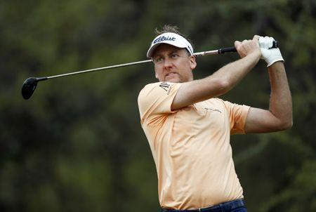 Mar 24, 2018; Austin, TX, USA; Ian Poulter of England plays against Louis Oosthuizen of South Africa during the fourth round of the WGC - Dell Technologies Match Play golf tournament at Austin Country Club. Mandatory Credit: Erich Schlegel-USA TODAY Sports