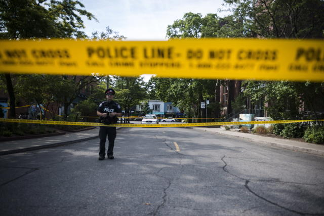 <p>Police are photographed at the perimeter of the scene of a mass shooting in Toronto on July 23, 2018. (Photo: Christopher Katsarov/The Canadian Press via AP) </p>