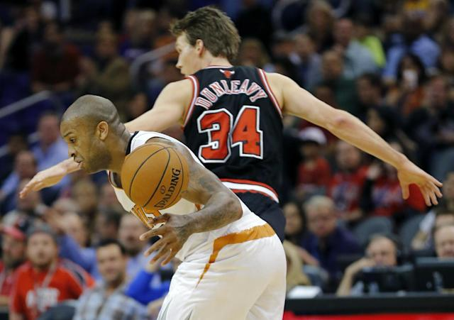 Chicago Bulls' Mike Dunleavy (34) looks for the lose ball as Phoenix Suns' P.J. Tucker tries to gain control during the first half of an NBA basketball game, Tuesday, Feb. 4, 2014, in Phoenix. (AP Photo/Matt York)
