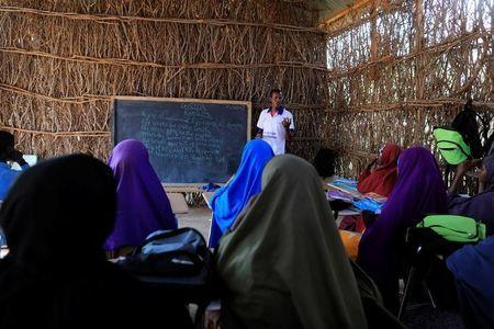 Zeinab's English teacher Abdiweli Mohammed Hersi teaches children at the school near a camp for internally displaced people from drought hit areas in Dollow, Somalia April 3, 2017. REUTERS/Zohra Bensemra