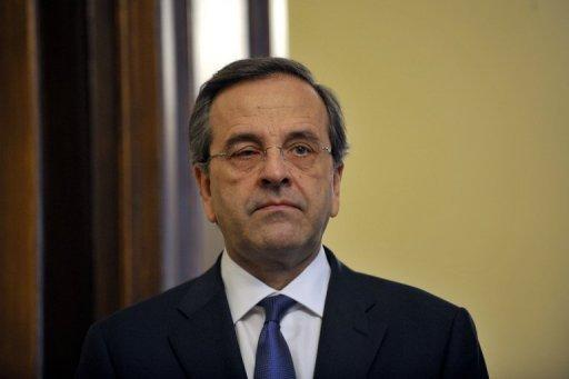 European Commission President Jose Manuel Barroso was to meet Prime Minister Antonis Samaras, seen here on July 5, as officials threw together a list of 11.6 billion euros in spending cuts to jumpstart reforms