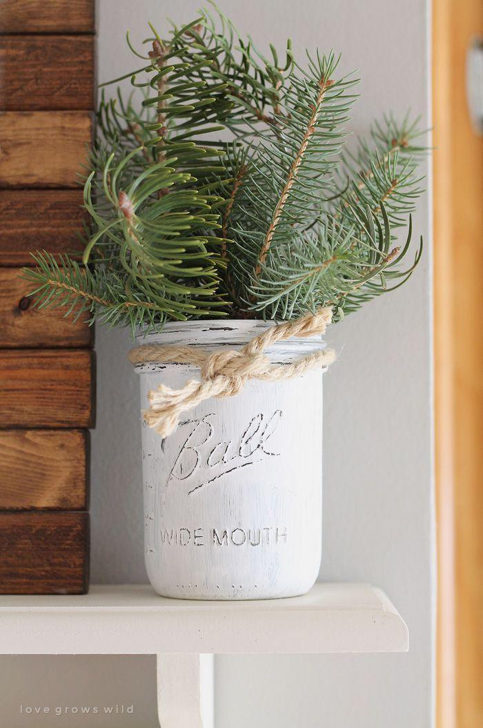 """<p>Use a distressed-white Mason jar, bits of evergreen, and some rope to add visual interest to a kitchen shelf.</p><p><strong>See more at <a href=""""http://lovegrowswild.com/2014/12/christmas-kitchen/"""" rel=""""nofollow noopener"""" target=""""_blank"""" data-ylk=""""slk:Love Grows Wild"""" class=""""link rapid-noclick-resp"""">Love Grows Wild</a>.</strong> </p><p><a class=""""link rapid-noclick-resp"""" href=""""https://www.amazon.com/FolkArt-Pl34150-Decor-Adirondack-Multicolor/dp/B00JRR21FY/?tag=syn-yahoo-20&ascsubtag=%5Bartid%7C10050.g.2132%5Bsrc%7Cyahoo-us"""" rel=""""nofollow noopener"""" target=""""_blank"""" data-ylk=""""slk:SHOP CHALK PAINT"""">SHOP CHALK PAINT</a><br></p>"""