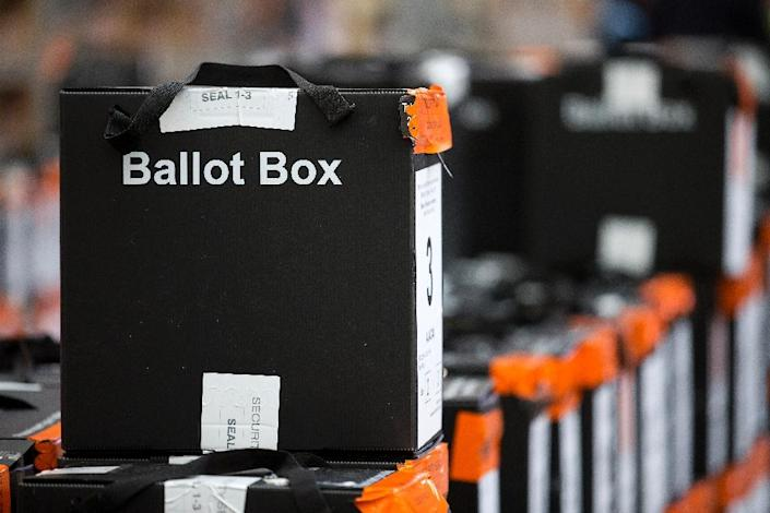 Sealed ballot boxes containing voting slips wait to be processed in north London on May 6, 2016 (AFP Photo/Justin Tallis)