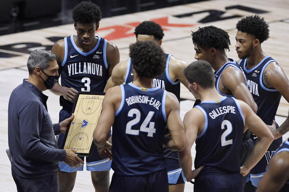 Villanova coach Jay Wright talks with the team during the first half of an NCAA college basketball game against Boston College, Wednesday, Nov. 25, 2020, in Uncasville, Conn. (AP Photo/Jessica Hill)