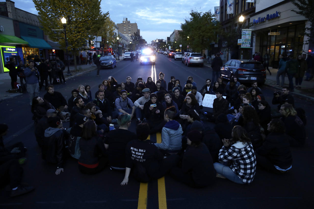 <p>Protesters demonstrate on a main road in the Squirrel Hill neighborhood of Pittsburgh on Oct. 30, 2018. (Photo: Matt Rourke/AP) </p>