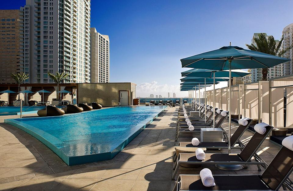 With its panoramic views of the Miami River and Biscayne Bay, the Kimpton Epic Hotel feels like a luxurious waterfront property. While public transportation options stop right outside the front door, everything guests need – restaurants, rooftop pools and a spa – are all on-site.