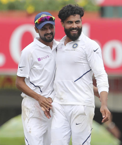 India's Ravindra Jadeja, right, celebrates with teammate Sahbaz Nadeem the dismissal of South Africa's Zubayr Hamza during the third day of third and last cricket test match between India and South Africa in Ranchi, India, Monday, Oct. 21, 2019. (AP Photo/Aijaz Rahi)