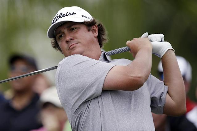 Jason Dufner hits from the 18th hole during the first round of the Cadillac Championship golf tournament Thursday, March 6, 2014, in Doral, Fla. (AP Photo/Wilfredo Lee)