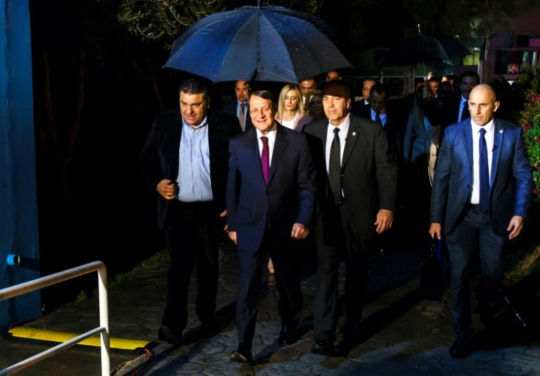 Incumbent Nicos Anastasiades, second from left, is favourite to win the presidential election, according to the polls