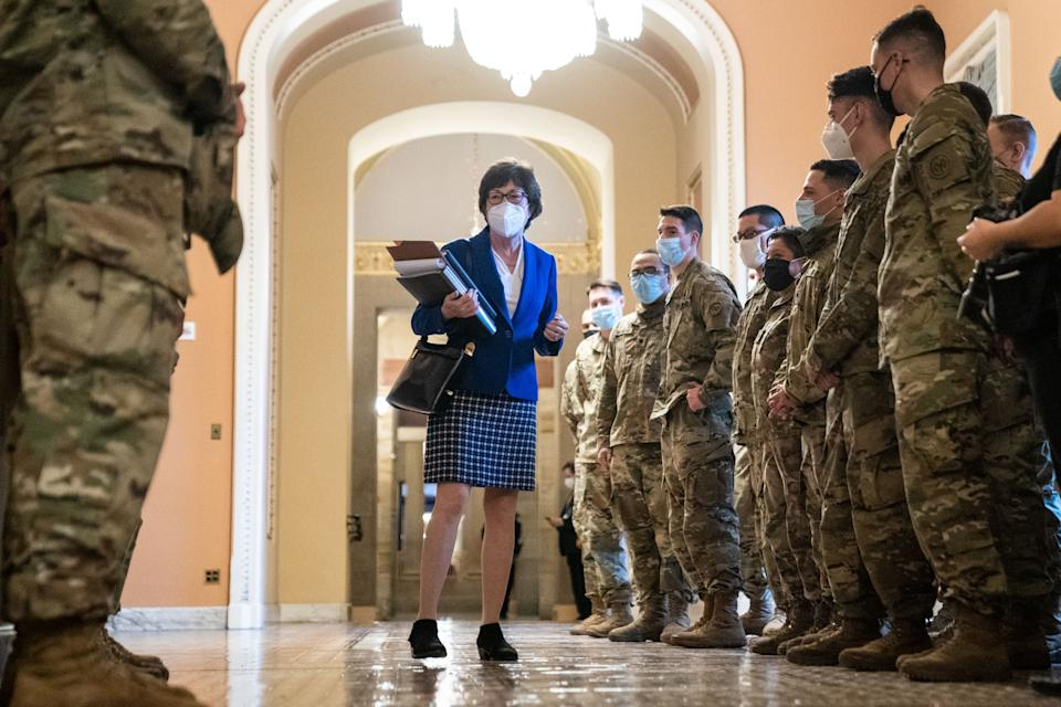 Sen. Susan Collins (R-ME), speaks with National Guard troops taking a tour of the U.S. Capitol Building on Thursday, Feb. 11, 2021 in Washington, DC. (Kent Nishimura/Los Angeles Times via Getty Images)
