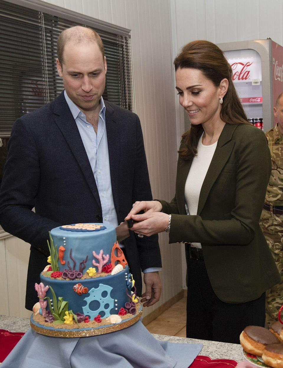 <p>The Duke and Duchess cut an under the sea-themed cake, as they opened a recreation area on the the Akrotiri Royal Air Force base in Cyprus. Jury is still out as to why the cake was underwater-themed. </p>