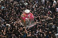 Thousands of Shia Muslims –- many not wearing masks -- gathered in the eastern Pakistani city of Lahore for an annual religious procession