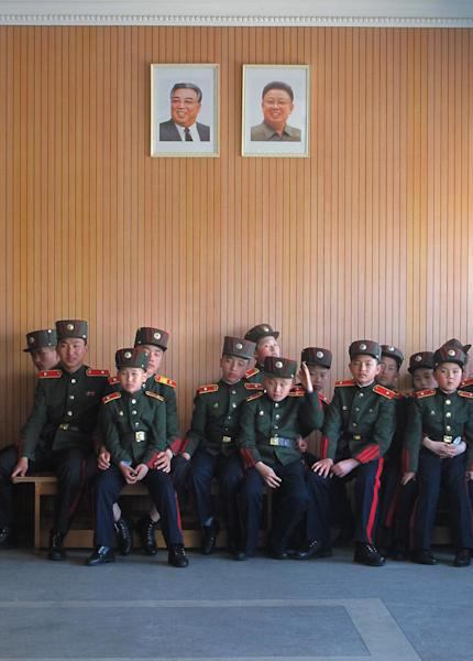 In this Thursday, April 18, 2013 photo, students at the Mangyongdae Revolutionary School, in Pyongyang, North Korea sit under portraits of the late leaders Kim Il Sung and Kim Jong Il. The school is run by the military and school administrators say it was originally set up in 1947 for children who had lost their parents during Korea's fight for liberation from its Japanese occupiers. (AP Photo)