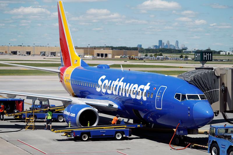 In this July 17, 2018, photograph, ramp workers prepare a Southwest Airlines Boeing 737 for departure to Denver from Minneapolis International Airport in Minneapolis. Southwest Airlines overcame rising fuel prices to top profit expectations, though an inflight disaster in which a passenger was killed had an adverse effect on revenue. Second-quarter earnings were $733 million, topping Wall Street expectations. (AP Photo/David Zalubowski) ORG XMIT: NYAG401