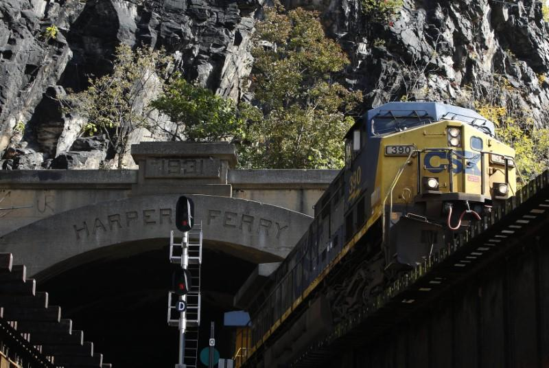 A CSX freight train heads westbound out of a tunnel into Harpers Ferry, West Virginia