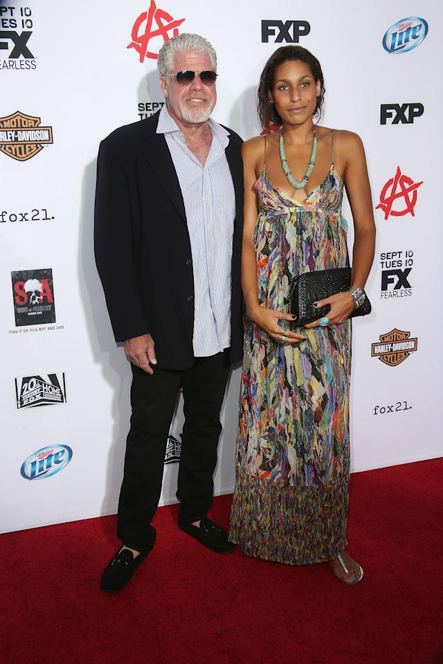 "HOLLYWOOD, CA - SEPTEMBER 07: Actor Ron Perlman (L) and his daughter Blake Perlman attend the Premiere of FX's ""Sons of Anarchy"" Season 6 at the Dolby Theatre on September 7, 2013 in Hollywood, California. (Photo by Frederick M. Brown/Getty Images)"