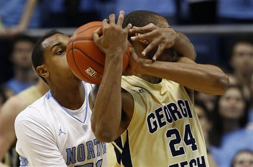 North Carolina's John Henson, left, guards Georgia Tech's Kammeon Holsey (24) during the first half of an NCAA college basketball game in Chapel Hill, N.C., Sunday, Jan. 29, 2012. (AP Photo/Gerry Broome)