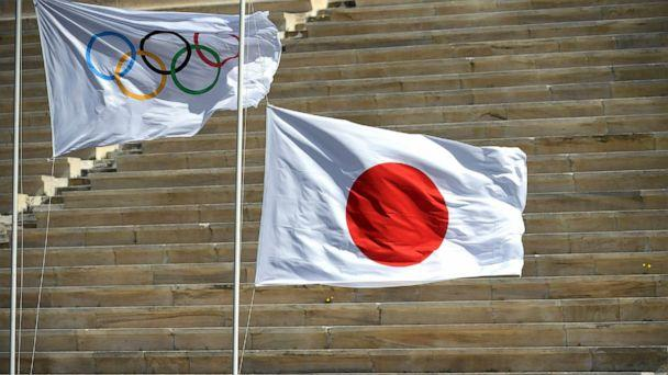 PHOTO: Japan's flag is raised next to the Olympic flag during the olympic flame handover ceremony for the 2020 Tokyo Summer Olympics, March 19, 2020, in Athens. (Aris Messinis/AFP/Getty Images)