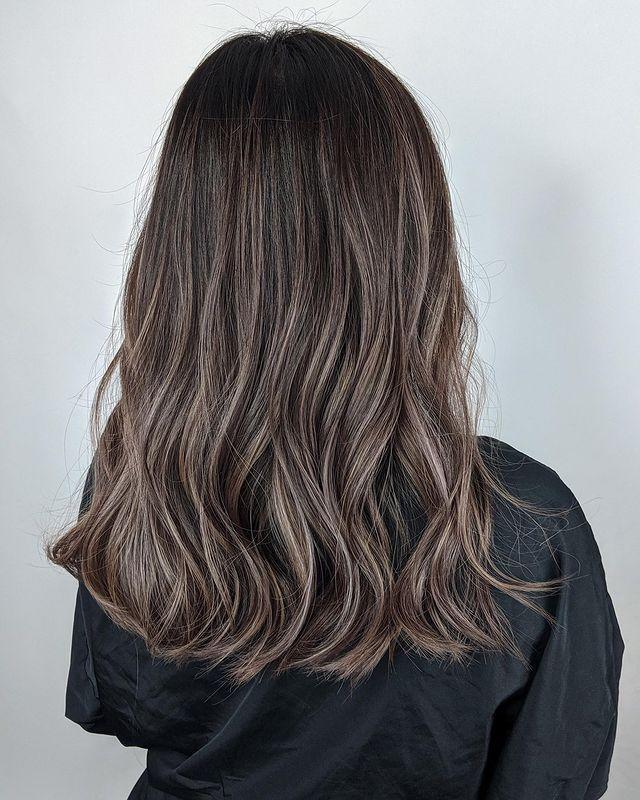"""<p>Here's another cute idea: Keep your ash-brown highlights contained to the lower half of your hair for <strong>a pretty contrast between your <a href=""""https://www.cosmopolitan.com/style-beauty/beauty/g28971659/shadow-root-hair-highlights/"""" rel=""""nofollow noopener"""" target=""""_blank"""" data-ylk=""""slk:roots"""" class=""""link rapid-noclick-resp"""">roots</a> and en</strong><strong>ds.</strong></p><p><a href=""""https://www.instagram.com/p/CJmOEyqMix6/"""" rel=""""nofollow noopener"""" target=""""_blank"""" data-ylk=""""slk:See the original post on Instagram"""" class=""""link rapid-noclick-resp"""">See the original post on Instagram</a></p>"""